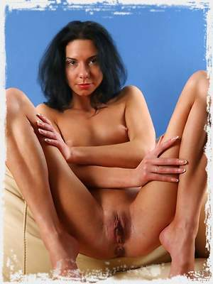 Brunette Sandra loves to pose her shaved pussy and ass