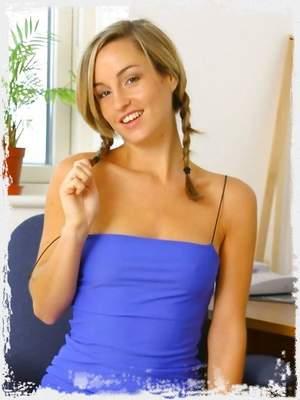 Melanie in a sexy blue minidress with stockings.