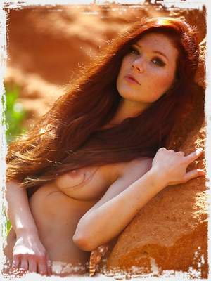 This photo set of the adorable Mia Sollis reminds us of why we love red heads.Mia practices some relaxing yoga poses amongst the rocks on the beautiful Algarve coast. At the same time; Mia affords us the occasional glimpse of the fascinating 'Kama Sutra' sex position tattoo on her back. As if Mia's beautiful hair and toned body weren't enough...we have to wonder...why the fascination with that sexual position?... We can only guess!