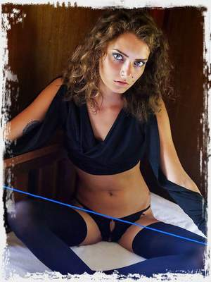 Jacinta B erotically tied Leocadia's naked body as she lays on the bed.