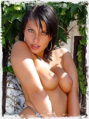 Marketa enjoys a warm day outdoors in her sexy blue bikini